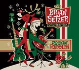 ブライアン・セッツァー・オーケストラ、新クリスマス・アルバムはアニメ「フリントストーン」のテーマ下敷きにした楽曲が目玉
